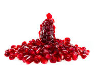 Pile of fresh ripe pomegranates on white isolated background