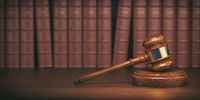 Gavel on the background of vintage lawyer books. Concept of law and justice.