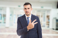 Real estate manager showing number three or third