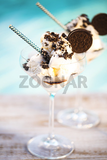 Vanilla sundae ice cream with chocolate sauce and cookies