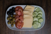 Plate with cheese and vegetables