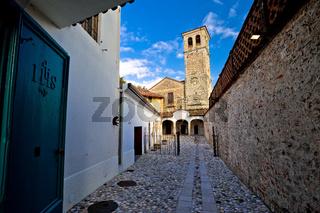 Stone ancient Italian street and church in Cividale del Friuli