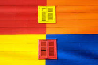 Colorful wall with two windows in La Boca, Buenos Aires