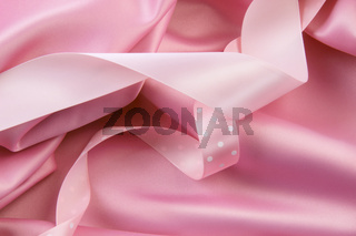 Pink satin silk  background with ribbons