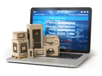 Cardboard boxes with appliaces on PC  laptop keyboard. E-commerce, online shopping and delivery concept.