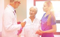 medics and senior patient woman at hospital