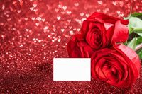 Red roses on glitters