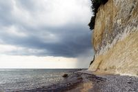 Steep coast of the island of Rügen and a rebounding storm