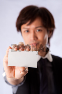Asian business man with white card