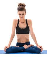 Yoga. Cute brunette sitting in lotus position