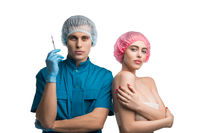 Plastic surgeon with syringe and pretty patient