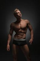 Advertising underwear. Photo of sexy man in briefs