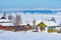 Winter morning view of the village houses by Baikal lake.
