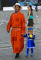 Father and daughter in a traditional deel costumes, Mongolian National Costume Festival, Ulaanbaatar