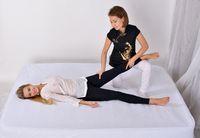 Thai Massage. Massage therapist working with woman