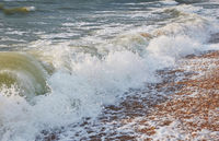 Wave and sandy shore background, stormy weather