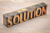 solution banner in wood type