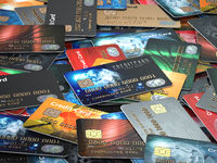 Pile of colored credit cards background,