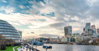 View from Tower Bridge on London Cityscape panorama with  HMS Belfast iand Town Hall