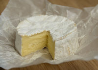 Camembert on a wooden board