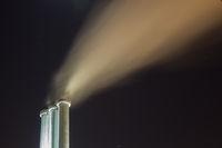 Powerplant chimneys at night