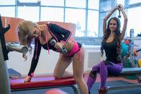 At gym. Photo of training athletes