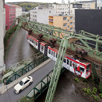 suspension monorail over river Wupper and car, Wuppertal, Germany, Europe