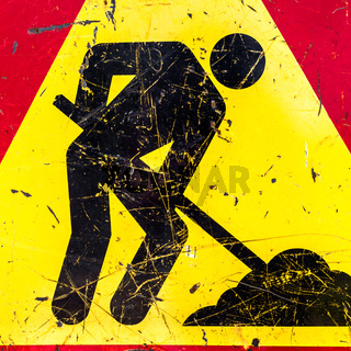 Men at work sign at a road construction site