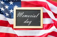 memorial day words on chalkboard and american flag