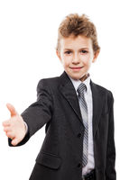 Smiling child boy in business suit gesturing hand greeting or meeting handshake