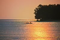 Rowers at sunset on Lake Constance