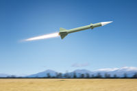 nuclear rocket bomb flying over a landscape field