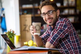 Handsome freelance man working