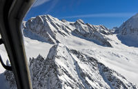 Bird's eye view from a helicopter across the snow-covered glacier Langgletscher, Valais, Switzerland