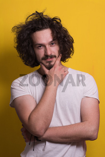 young man with funny hair over color background