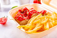 grilled bratwurst with French fries and ketchup