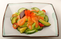 Raw salmon salad with fish roe and garden vegetables.