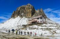 Hikers on the way to the Dreizinnenhütte, Rifugio Locatelli hut, Sesto Dolomites, South Tyrol,Italy