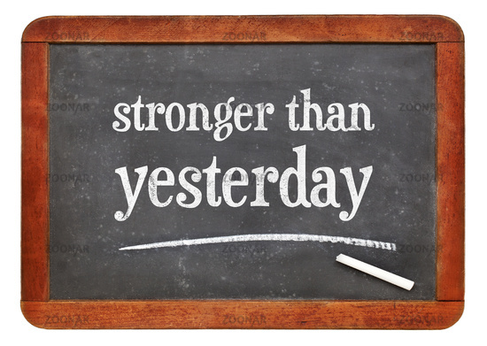 stronger than yesterday text on blackboard