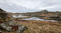 Beautiful landscape with a pond in the Rovaer island in Rovaer archipelago in Haugesund, Norway.