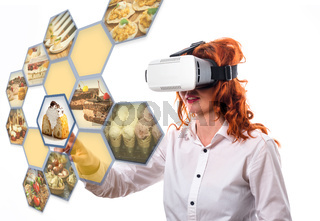 Virtual reality concept - women choosing from menu
