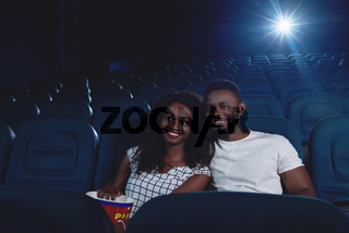 Ccouple of africans watching funny movie.