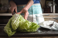 Woman cut Chinese cabbage to cook kimchi