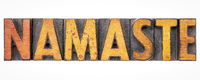 namaste word abstract in wood type