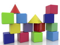 Toy blocks in various colors on white