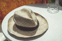 old straw hat on a table