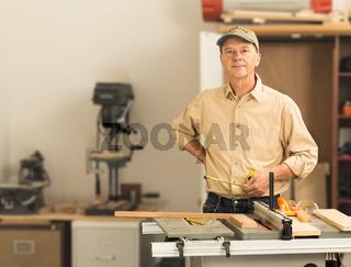 Senior caucasian man in home workshop