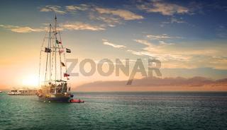 Sailboat at sunny sunset