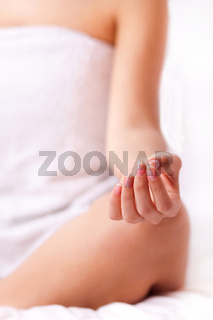 Close up shot of a young girl fingers while doing meditation