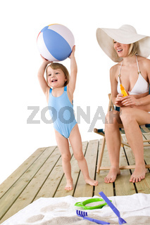 Beach - Mother with child playing with toys